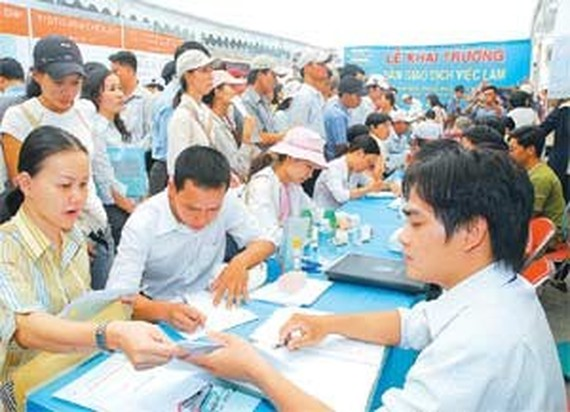 Job seekers register for interview at the fair