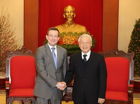 General Secretary of the Communist Party of Vietnam Nguyen Phu Trong (R) and French Ambassador to Vietnam Bertrand Lortholary