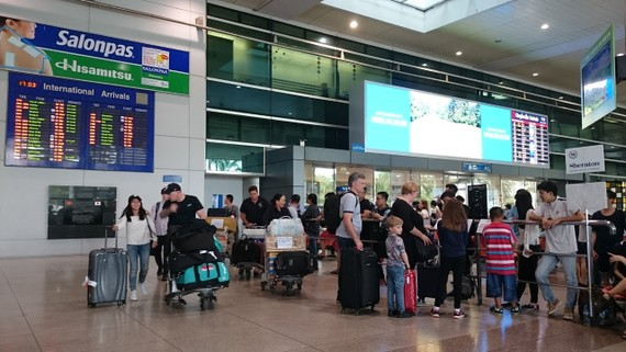 Passengers queuing to get checked in at Tan Son Nhat airport