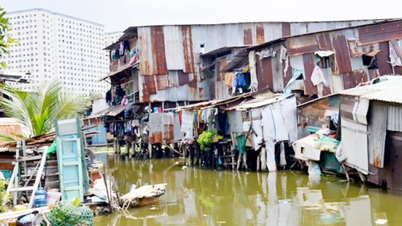 Canal houses in Binh Thanh province. Canal house removal is one of content of the city's breakthrough program on urban planning and development (Photo: SGGP)