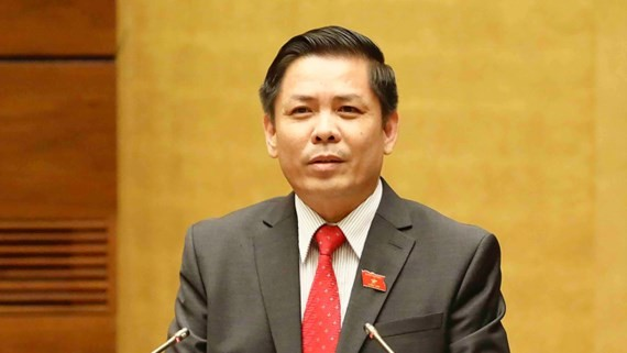 Minister of Transport Nguyen Van The reads the statement on the policy of building North-South Expressway at the meeting