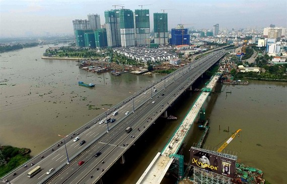 Construction of Urban Railway Metro Line 1 crosses Saigon River in HCM City. The city - the 'economic locomotive' of the country, is facing numerous challenges including increasing population, insufficient infrastructure development and environmental poll