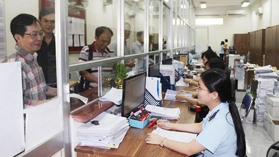 Business do customs procedures in HCMC (Photo: SGGP)