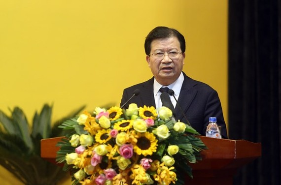 Deputy Prime Minister Trinh Dinh Dung speaks at the meeting of PetroVietnam on January 12 (Photo: VNA)