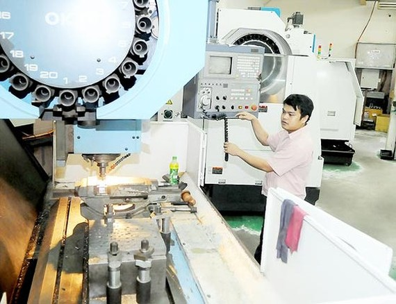 Mechanical molds manufacturing at Lap Phuc Mechanic Company (Photo: SGGP)