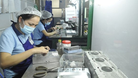 Mechanical production is accessible to HCMC's investment stimulation program (Photo: SGGP)