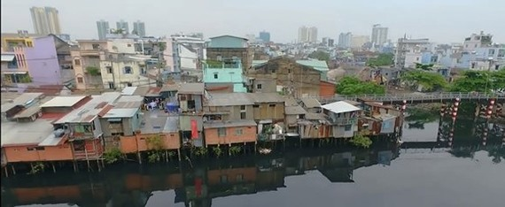 HCMC is making efforts to remove all canal houses by 2025 (Photo: SGGP)