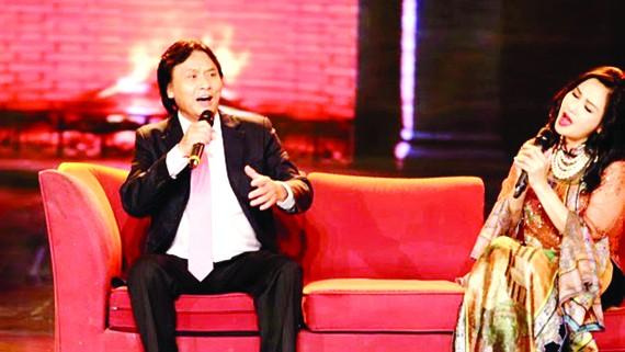 Ca sĩ Quang Lý cùng ca sĩ Thanh Lam trong một chương trình âm nhạc