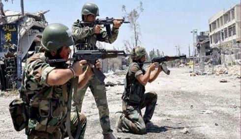 Quân đội Syria ở Homs. Ảnh: ALALAM
