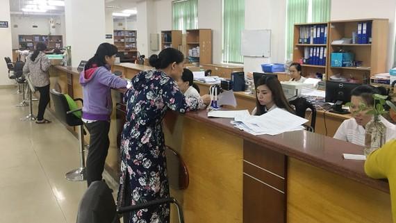 BHXH TPHCM tiếp nhận hồ sơ tham gia BHYT và điều chỉnh sai sót trong hồ sơ  của người tham gia BHYT hàng ngày