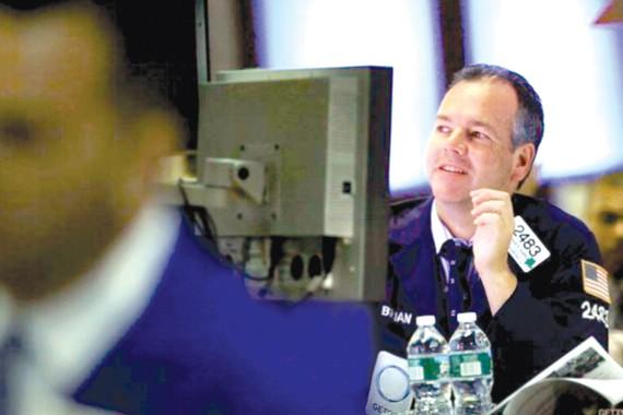 Nhà đầu tư tại phố Wall phấn khởi khi thị trường chứng khoán tăng điểm