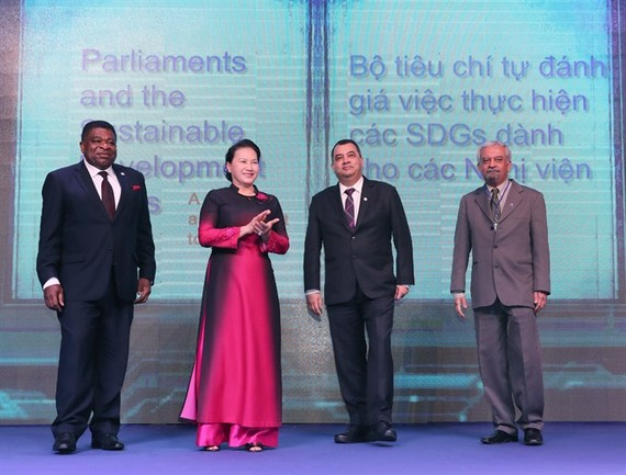 National Assembly Chair Nguyễn Thị Kim Ngân (second, left) with Saber Chowdhury, IPU president (second, right), IPU's Secretary General Martin Chungong (first, left) and Kamal Malhotra, UN Resident Coordinator in Việt Nam introduce tools to assess impleme