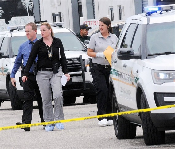 Investigators work the scene of a multiple shooting at an area business in an industrial area on Monday, northeast of downtown Orlando, Florida