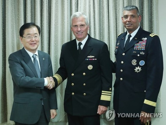 Chung Eui-yong (L), director of South Korea's presidential National Security Office, shakes hands with V. Adm. James Syring, director of the U.S. Missile Defense Agency, before their meeting in Seoul on June 5, 2017. (Photo courtesy of Cheong Wa Dae) (Yon
