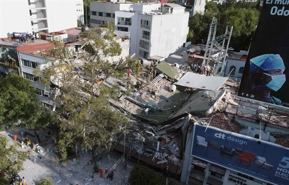 View of buildings flattened by a powerful quake in Mexico City on September 19. A devastating quake in Mexico on Tuesday killed more than 100 people, according to official tallies, with a preliminary 30 deaths recorded in the capital where rescue efforts