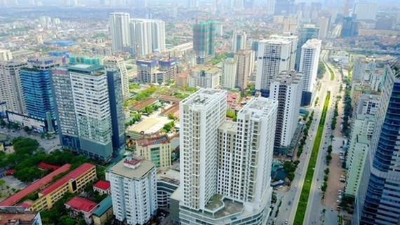 Việt Nam witnessed positive development in the real estate market in 2017 with increased transactions of apartments and reduction in real estate inventory. — Photo realtimes.vn