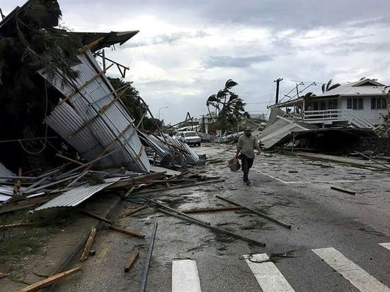 Flooding and damage in Tonga's capital of Nuku'alofa after Cyclone Gita hit the country. — AFP/VNA Photo