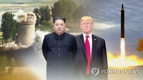 This image from Yonhap News TV shows North Korean leader Kim Jong-un (L) and U.S. President Donald Trump. (Yonhap)