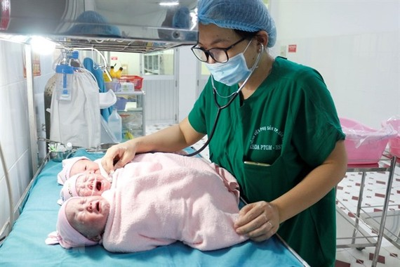 A woman gave birth to triplets---all girls---in a rare case. The babies are in good health. — VNA/VNS Photo Thanh Sang
