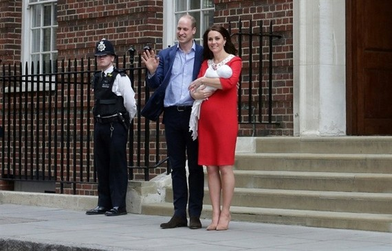 Britain's Prince William and Kate, Duchess of Cambridge wave holding their newborn baby son. — AFP Photo