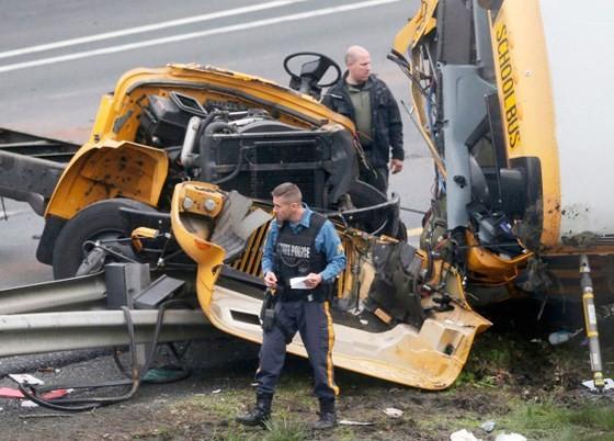 US school bus crash: one student, one teacher killed