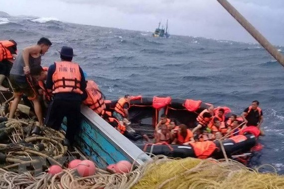 "Rescued tourists are brought aboard a fishing boat, but the Phuket governor's office says ""dozens of Chinese"" are missing after their tourist boat capsized. (Photo: Phuket Department of Disaster Prevention and Mitigation)"
