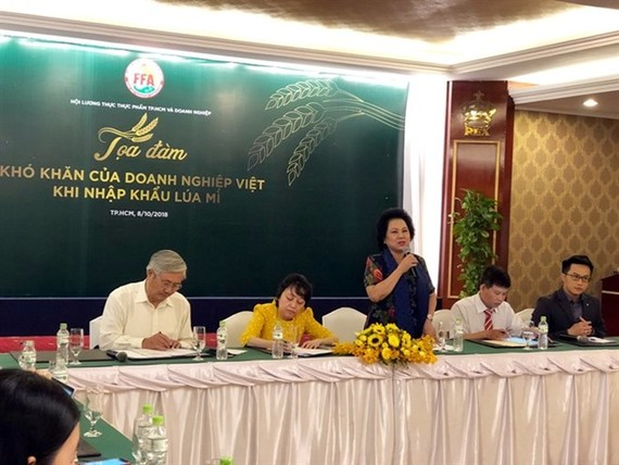 Ly Kim Chi, Chairwoman of the HCM City Food and Foodstuffs Association, speaks at the seminar held by the association to discuss difficulties faced by businesses when importing wheat.(Photo: VNA)