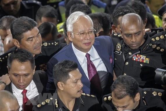 Malaysia's former Prime Minister Najib Razak (in suit) (Photo: EPA/VNA)