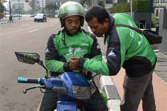 Drivers of Indonesia's ride-hailing service provider Go-Jek (Photo: AFP/VNA)