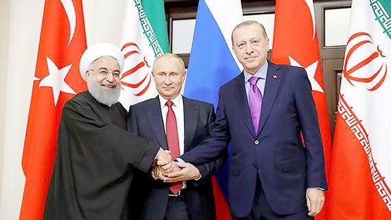 Mỹ tăng các biện pháp trừng phạt khiến các nước Iran, Nga, Thổ Nhĩ Kỳ xích lại gần nhau hơn. Ảnh: REUTERS