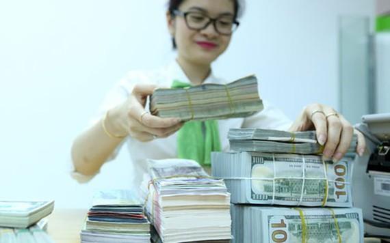 Tỷ giá trung tâm tăng mạnh theo giá USD thế giới