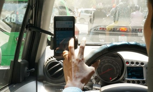 Hà Nội yêu cầu báo cáo số lượng, danh sách lái xe Uber, Grab
