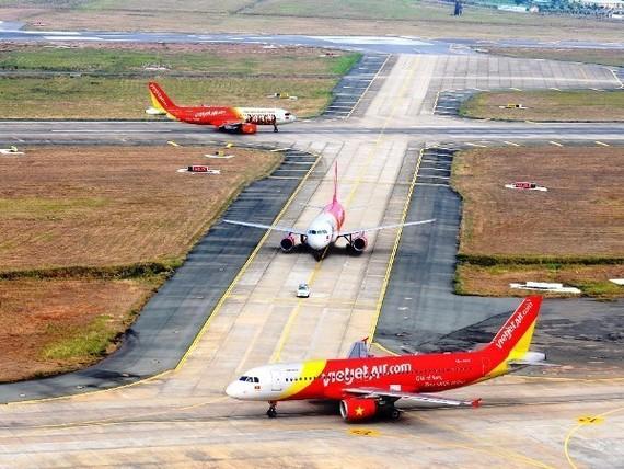 Sự phát triển của hàng không giá rẻ đã giúp nhiều hành khách có cơ hội được đặt chân lên máy bay. (Ảnh: Vietjet cung cấp)