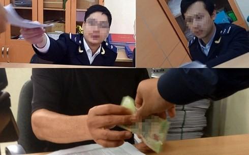 Các cán bộ hải quan dính nghi án nhận lót tay (Ảnh cắt từ clip của Báo Lao Động).