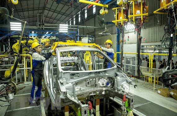 Hoạt động sản xuất tại nhà máy ôtô Hyundai Thành Công. (Ảnh: Hoàng Hùng/TTXVN)