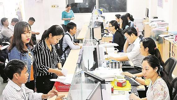 Giải quyết hồ sơ đăng ký kinh doanh tại Sở Kế hoạch và đầu tư TPHCM Ảnh: CAO THĂNG
