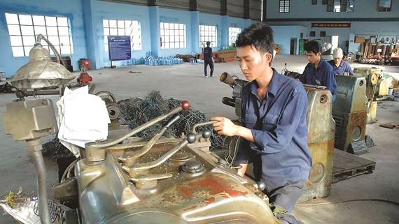 Doanh nghiệp nhỏ và vừa đang gặp khó khăn về vốn, công nghệ sản xuất... để phát triển. Ảnh: Cao Thăng