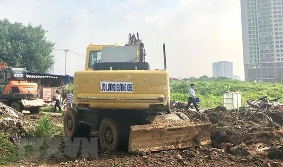 Hiện trường một buổi thu hồi đất ở Hà Nội. (Nguồn: TTXVN)