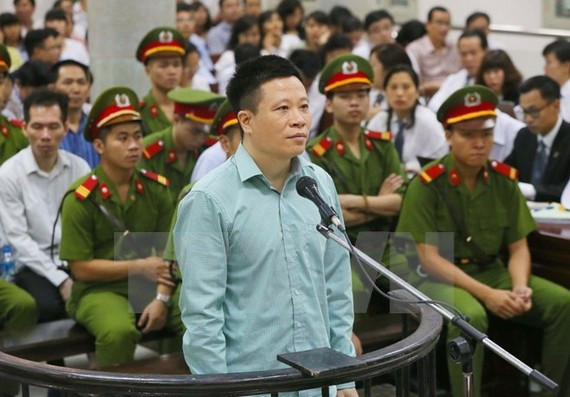 Former OceanBank Chairman Ha Van Tham in court (Source: VNA)