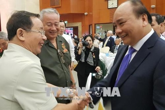 Prime Minister Nguyen Xuan Phuc attends the get-together to celebrate  the 50th anniversary of the Tet Offensive in Spring 1968.  (Photo: VNA)