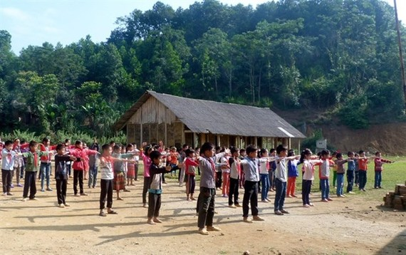 Students at Dao Vien Primary School in Yen Son District of the northern mountainous province of Tuyen Quang take part in a morning exercise session. (Photo:VNA)