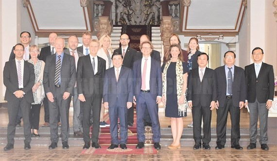 Chairman of the People's Committee of HCM City Nguyen Thanh Phong and the delegation of Sweden's UppsalaCounty