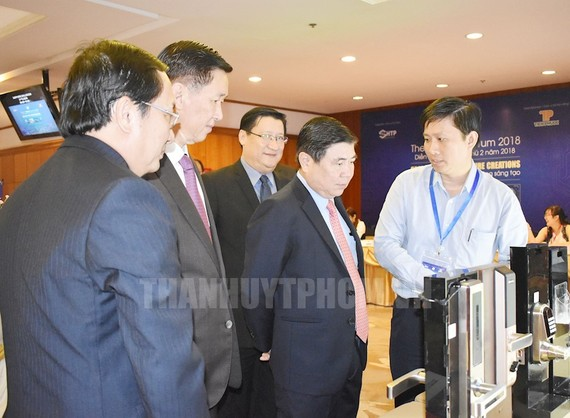 Chairman of the municipal People's Committee Nguyen Thanh Phong attends the forum. (Photo: hcmcpv)