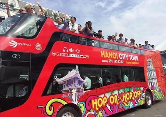 Open-top double-decker bus tour  in Hanoi