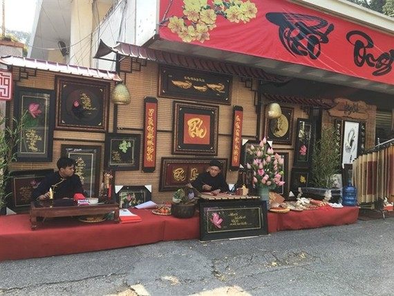 The calligraphy market at the Labour Cultural House is one of two traditional calligraphy markets open in HCM City during the Tet holiday season (Photo: VNA)