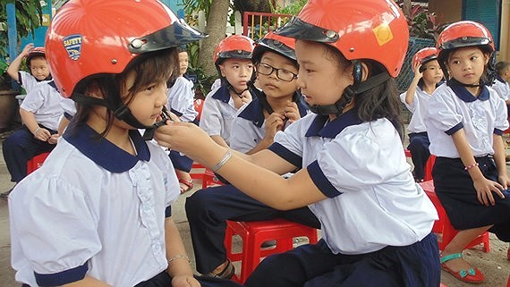 Traffic safety committee gives helmets to all first graders