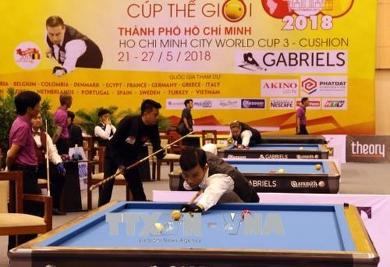 Qualifier round of the Three-Cushion Carom Billiards World Cup on May 24 (Photo: VNA)