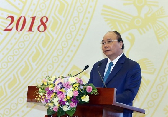 Prime Minister Nguyen Xuan Phuc addresses national teleconference between the Government and localities