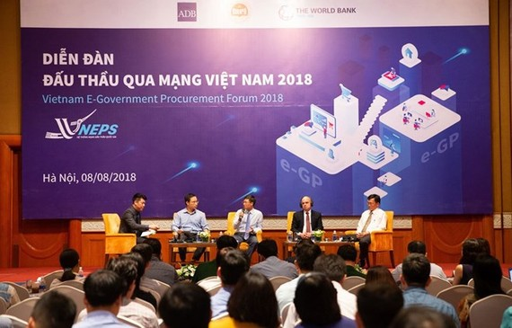 The first national forum on e-procurement takes place in Hanoi on August 8 (Photo: baodauthau.vn)