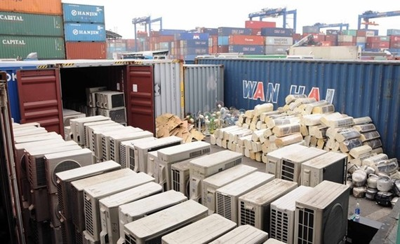 Hundreds of used home electronics banned from import found in containers at Cat Lai Port in HCM City. (Photo: VNA)